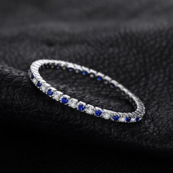 Кольцо с синим шпинелем и цирконием , 2410